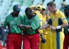 Brett Lee pats Kennedy Obuya as the latter is assisted off the field