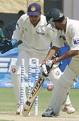 Mohammad Sami is bowled as Parthiv Patel watches