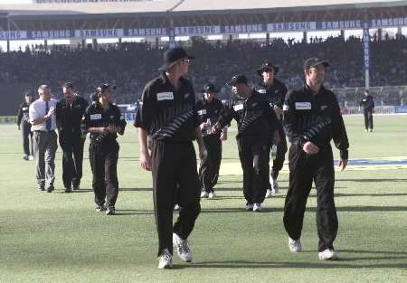 New Zealand team going off after a crowd disturbance