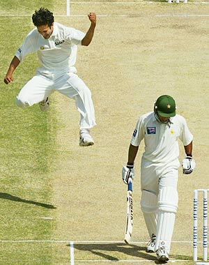 Irfan Pathan extracts bounce from the pitch after dismissing another batsman