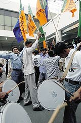 Its all fun and frolic for the supporters after India's historic series victory © AFP