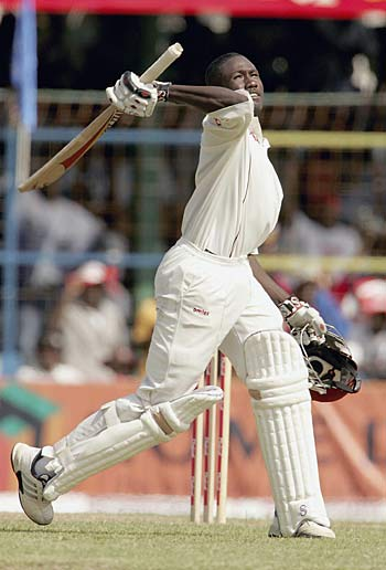 A delighted Wavell Hinds reaches his hundred