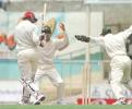 Adrian Griffith finds himself bowled by Mushtaq Ahmed