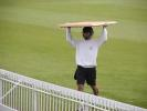 Andy Bones, Oxford UCCE wicket-keeper protects himself from another downpour