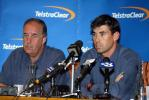 New Zealand captain Stephen Fleming (right) speaks at a press conference at Auckland Airport while coach Denis Aberhart looks on. The New Zealand team returned from Pakistan after a bomb blast outside their Karachi hotel caused the tour to be cancelled just prior to the second Test. 10 May 2002.