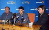 Fleming speaks at a press conference at Auckland Airport while Aberhart and Snedden look on