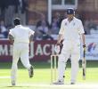 Rueful Freddie Flintoff as victorious bowler Fernando runs past him, Flintoff caught behind for 12, England v Sri Lanka, First Test, Lord's 2002