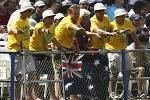 PORT OF SPAIN, TRINIDAD - MAY 24: Australian fans cheer on another Australian boundary during the 4th One Day International between the West Indies and Australia on May 24, 2003 at Queens Park Oval in Port of Spain, Trinidad.