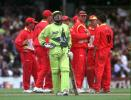 Pakistan batsman Moin Khan walks off as the Zimbabwe team celebrate his runout following the third umpire's decision during their Cricket World Cup Super Six match at The Oval in London 11 June 1999