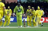 Pakistan's opening batsman Wajahatullah Wasti (C) walks  to the pavilion after he was out to a diving catch at second slip by Australia's Mark Waugh in the Cricket World Cup final at Lords in London, 20 June 1999