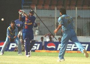 Sanath Jayasuriya smashes the ball through the on side
