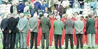 Lancashire players and committee stand as a mark of respect for Brian Statham who died today. National League Division One, 2000, Lancashire v Worcestershire, Old Trafford, Manchester 11 June 2000.