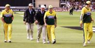 Steve Waugh speaks to umpire George Sharp as he leads his team off the field