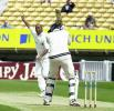 Sheikh of Warks wants the wicket of Fleming lbw, but not out