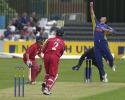 Bowler Jason Kerr tips the ball up from Stuart Law and catches it for a caught and bowled, Derby v Lancashire 23rd June 2002