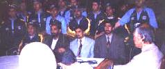 Seated: ACF President Allah Dad Noori (dark suit), National Sports Committee vice-president Dashti (light suit), to his right Ministerial Advisor Shahzada Masood and others during the ACF Annual General Meeting held in Kabul, 25 June 2003.