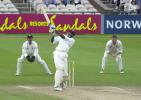 Curtly Ambrose whacks Cork for 4 at Old Trafford