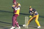 11 Aug 2000: Scott Muller of Queensland in action while Adam Gilchrist of Australia looks on during the Australia versus Queensland practice match played at Allan Border Field in Brisbane, Australia. The Australian team are playing the practice match to prepare for the Super Challenge 2000 against South Africa.
