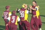 13 Aug 2000: Scott Prestwidge of Queensland celebrates with team mates after getting the wicket of Shane Warne of Australia during a practice match at Allan Border Field in Brisbane, Australia. The Australian team are playing the practice game against Queensland in Brisbane to prepare for the Super Challenge 2000 against South Africa.