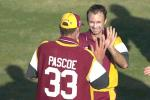 13 Aug 2000: Dale Turner of Queensland celebrates with team mate Matthew Pascoe after getting the wicket of Andrew Symonds of Australia during a practice match at Allan Border Field in Brisbane, Australia. The Australian team are playing the practice game against Queensland in Brisbane to prepare for the Super Challenge 2000 against South Africa.