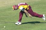 14 Aug 2000: Scott Prestwidge of Queensland strains to stop four runs against New Zealand during the New Zealand versus Queensland practice match at Allan Border Field in Brisbane, Australia. New Zealand scored 321 runs during their fifty overs.