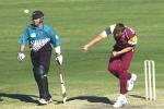 15 Aug 2000: Brendan Creevey of Queensland in action bowling while Craig McMillan of New Zealand looks on during the New Zealand versus Queensland practice match at Allan Border Field in Brisbane, Australia. Queensland won the game by 23 runs.