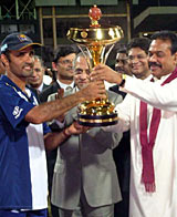 Marvan Atapattu receives the trophy after Sri Lanka's 25-run victory over India in the Asia Cup final © CricInfo Ltd