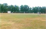 Play in progress during an Under-19 match at the Vellyani Agricultural College Ground