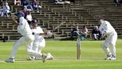 Essex keeper Foster sweeps to send the short leg scattering for cover, Scarborough 14th Sep 2001