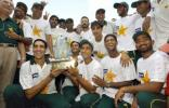 The jubilant Pakistan team poses with the trophy after their 1-wicket win,  Pakistan v Bangladesh, 3rd Test, Multan, September 6, 2003.