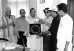 Mr. Jahangir Mughal, Convenor, Karachi Gymkhana Sports Committee presents a momento to the Kuwait Team Manager, Mirza Asad Baig.  Pictured from the left: Pakistani former Test bowler Mr. Khan Muhammad, former first-class cricketer, Mr. Bashir Ahmed, Mr Jahangir Mughal, Mr. Nasim-ul-Ghani, ICC Development Officer - Asia, Mirza Asad Baig, Faisal Al-Marsuq, Captain, Kuwait Cricket Team