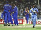 A terribly disappointed Tendulkar walks back as the Sri Lankans are delighted
