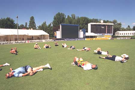 Prime Minister's XI team stretch at Manuka Oval, Canberra, 1999