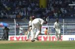 Hooper drives a ball past Zaheer Khan