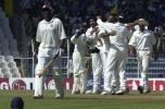 Indian players celebrate Hooper's dismissal