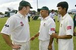 Australian captain Steve Waugh (L) chats with Bangladesh captain Khaled Mamud (C) and his teammate Sanwar Hossain (R) after Australia defeated Bangladesh on the fourth day of the second Test Match in Cairns, 28 July 2003. Australia dismissed Bangladesh for 163 in their second innings to win by an innings and 98 runs and took out the two match series 2-0.