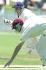 5 Nov 2000: Jason Arnberger of Victoria hits the ball past Matthew Anderson of Queensland during the Pura Cup match between Queensland and Victoria played at Allan Border Field in Brisbane, Australia.