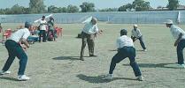 Raj Singh Dungarpur giving catch practice to Sodhi,Doru, Gambhir and Patel, (National Cricket Academy XI team), Zimbabwe in India, Nehru Stadium, 07 November 2000