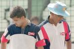Indian cricket team skipper Sourav Ganguly (L) passes coach Anshuman Geakwad as they arrive for a practice session at Bangabandhu National Stadium, 08 November 2000, in Dhaka. India will play a maiden test against Bangladesh from 10 to 14 November 2000.