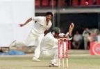 Bangladeshi bastman Shahriar Hossain crouches from a ball off Indian pacer Javagal Srinath 10 November 2000 at the Bangabandhu National Stadium during this South Asian country's inaugural Test match against India. Shariar who scored 12, before being caught by the Indian skipper Sourav Ganguly off Sunil Joshi.