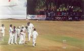 Shahbuddin being congratulated by team members after Ganesh got out, Ranji Trophy South Zone League, 2000/01, Karnataka v Andhra, Union Gymkhana Ground, Belgaum, 15-18 November 2000 (Day 2).