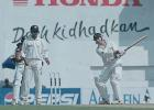 Ganguly watches Whittall as he uses his bat to get rid of an insect