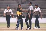 Friends at the end. Mahela shakes hands with member of a disappointed Colts side