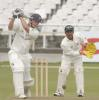 Andrew Puttick drives a ball against North West at Newlands on Friday