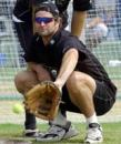 Chris Cairns plays baseball during practice at Hyderabad, TVS Cup 2003
