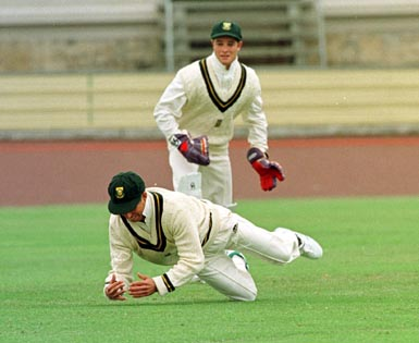 Mark Boucher watches as Dave Richardson drops a slip chance