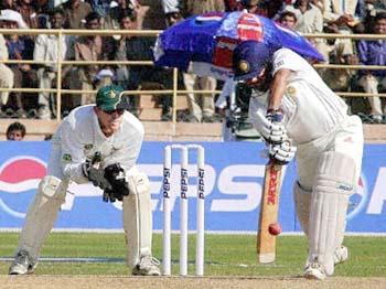 Tendulkar drives the ball past the bowler