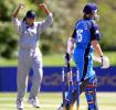 England's Arran Thompson walks away from the stumps as Sri Lankan bowler Rasanjali Silva celebrates