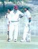 Rajesh Borah in a mid pitch conference with S Ganesh Kumar. Ranji Trophy East Zone League, 2000/01, Tripura v Assam, Maharaja Bir Bikram College Stadium, Agartala, 14-16 December 2000.