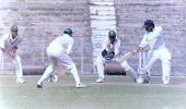 S Bose of Tripura cuts the ball. Ranji Trophy East Zone League, 2000/01, Tripura v Assam, Maharaja Bir Bikram College Stadium, Agartala, 14-16 December 2000.